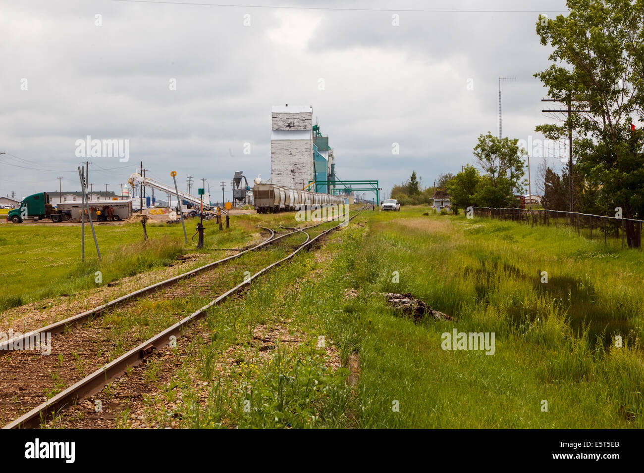 Railway and old grain elevators falling into disuse in Rycroft, Alberta,Canada - Stock Image