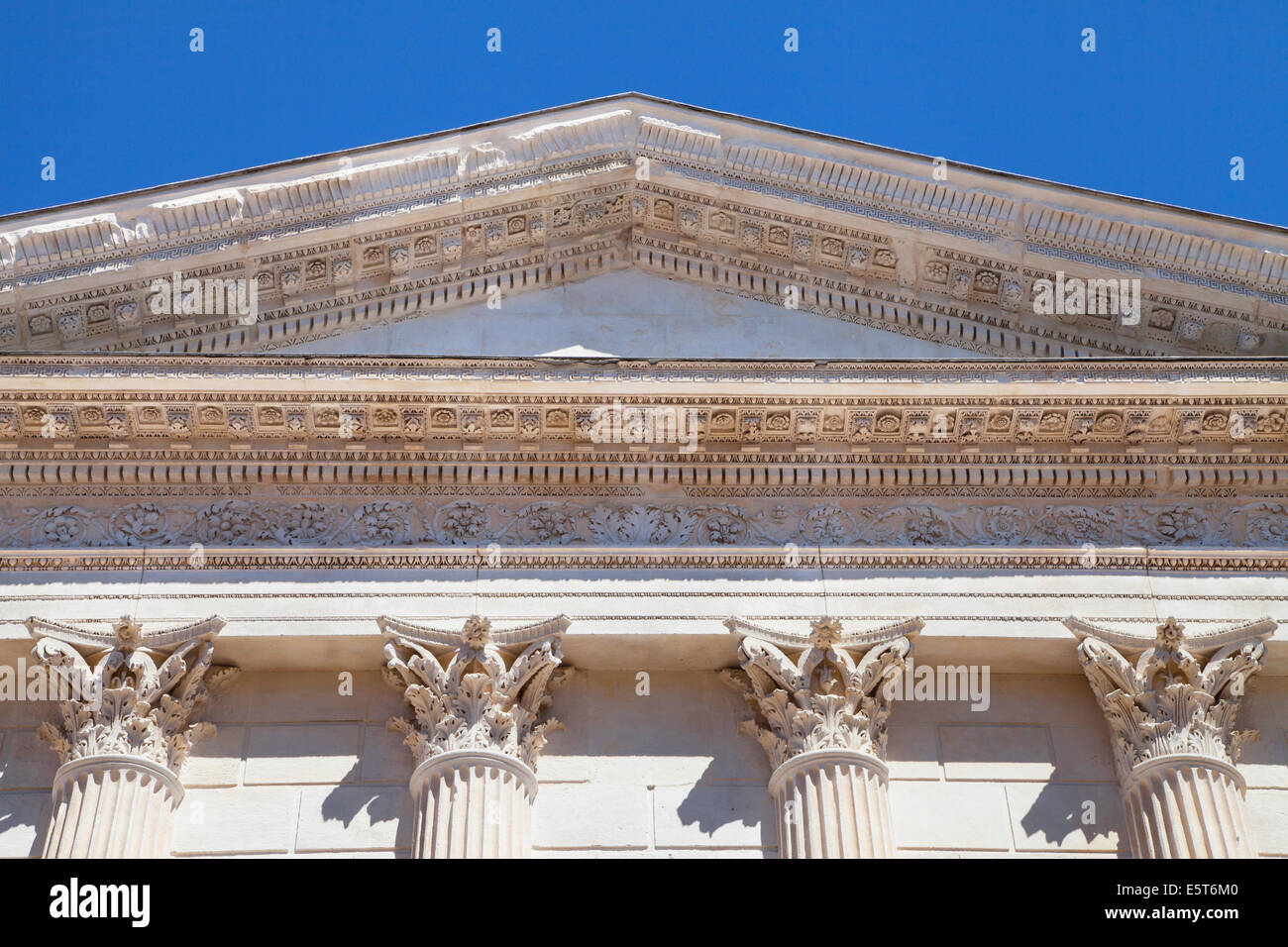 Pediment and Corinthian capitals of the Maison Carree, Nimes, France. - Stock Image
