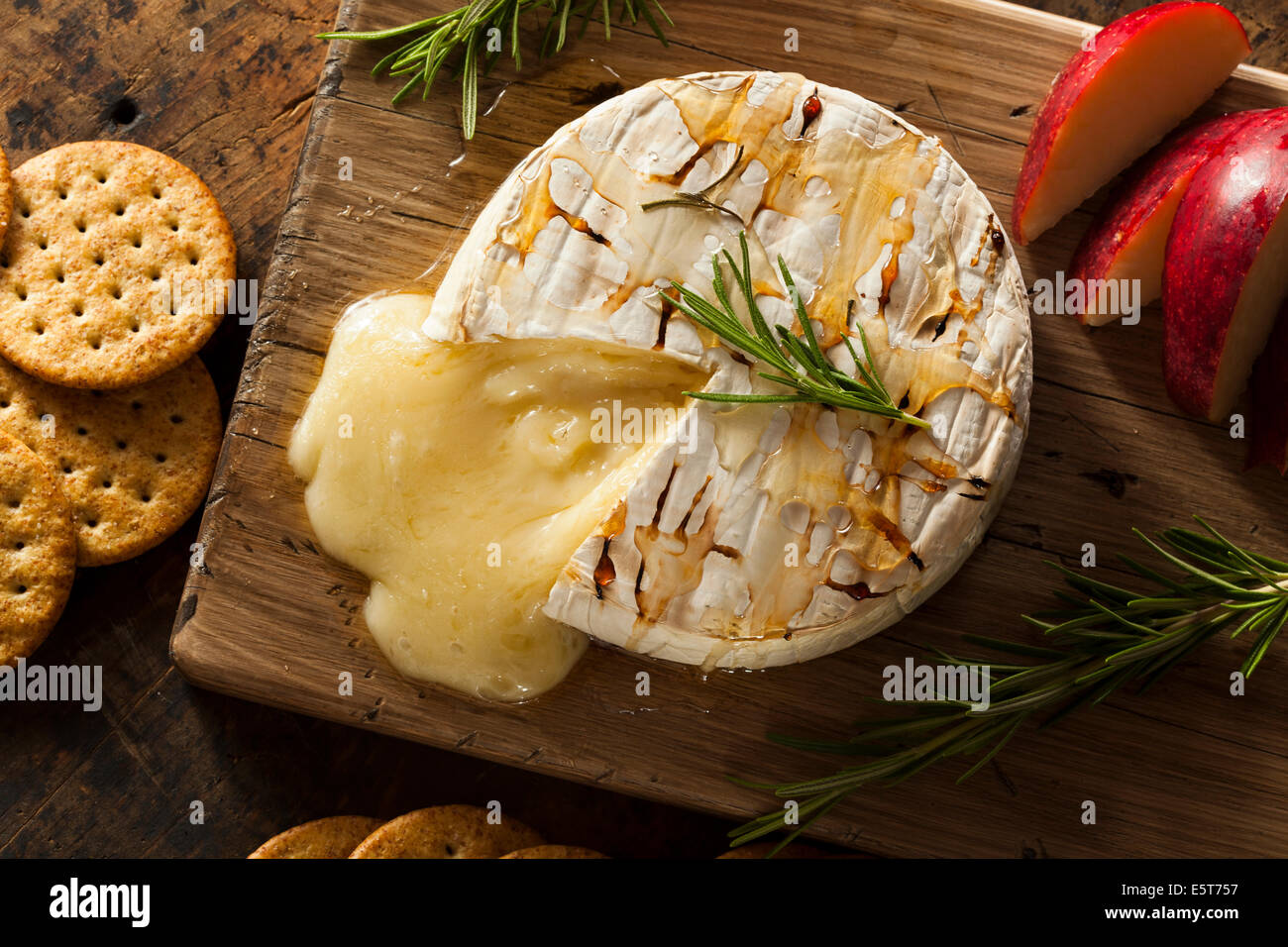 Homemade Baked Brie with Honey and Rosemary - Stock Image