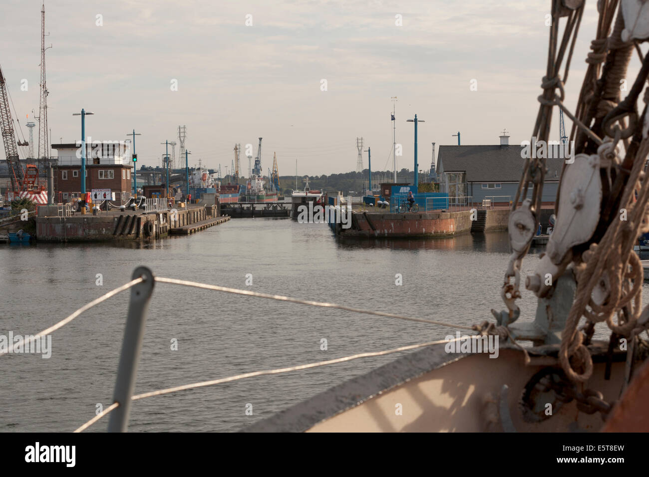 Bow of barge entering lock gates terminal on River Orwell; Ipswich. - Stock Image