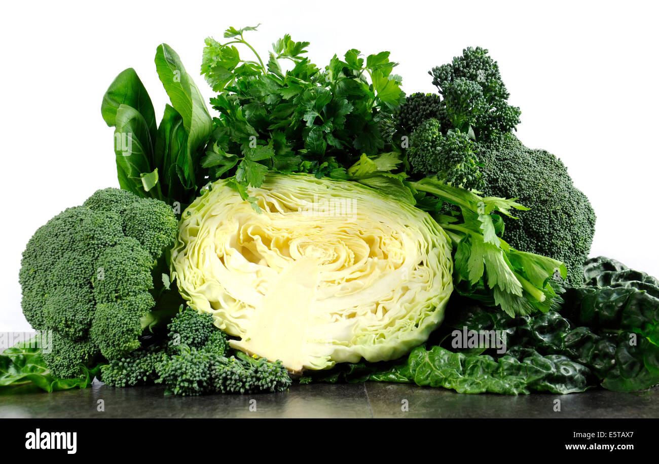 Healthy diet health foods with leafy green vegetables including cabbage, broccoli, broccolini, parsley, celery, - Stock Image