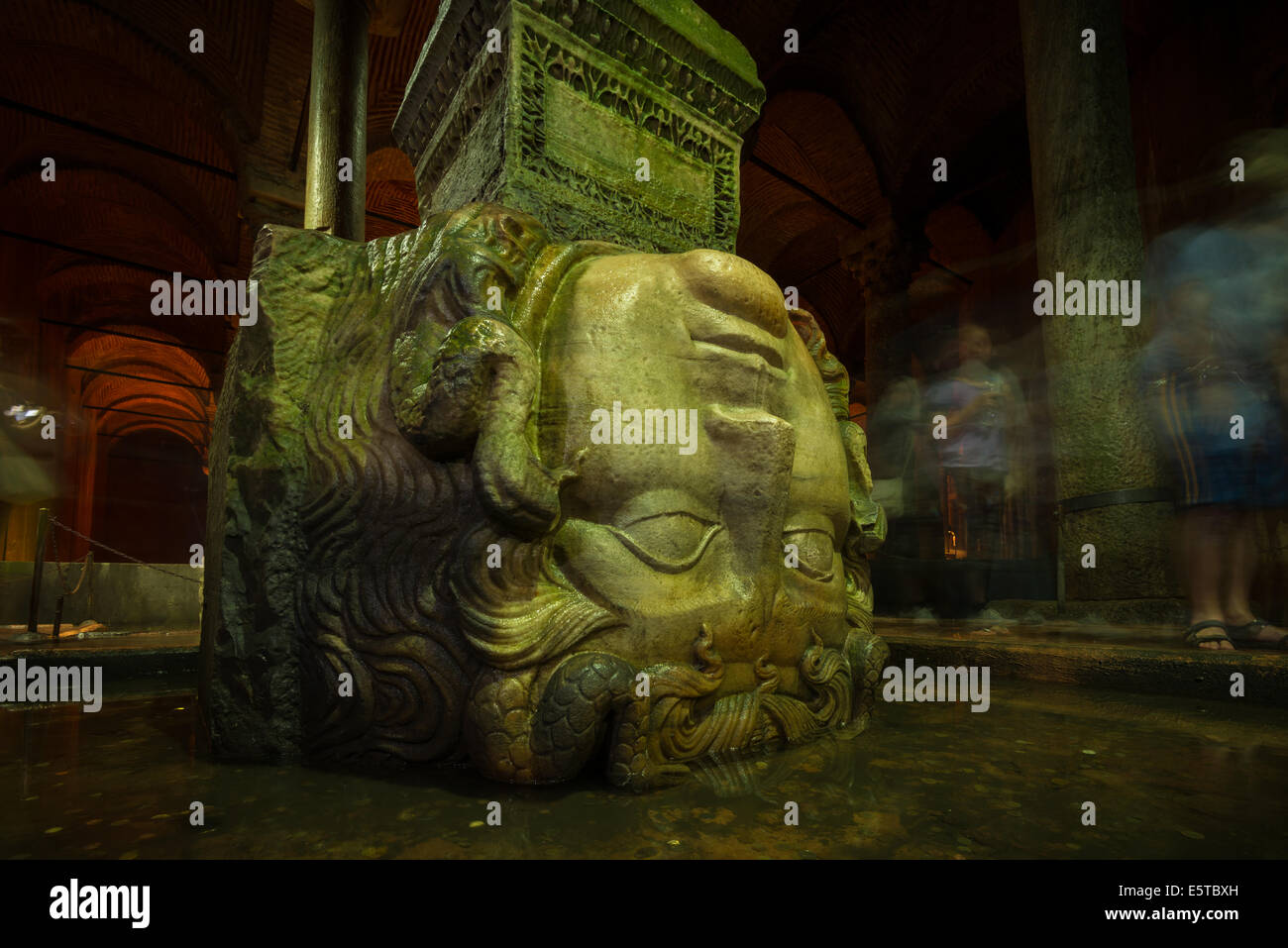 A giant Medusa head supports a column at the Basilica Cistern in Istanbul, Turkey. - Stock Image