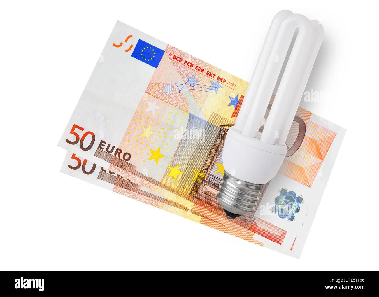 Energy saver bulb over euro bills on white background - Stock Image