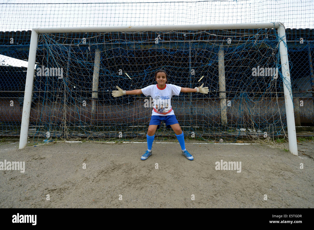 Teenager, 16 years, goalkeeper, standing in the goal with outstretched arms, Craque do Amanha social project, São - Stock Image