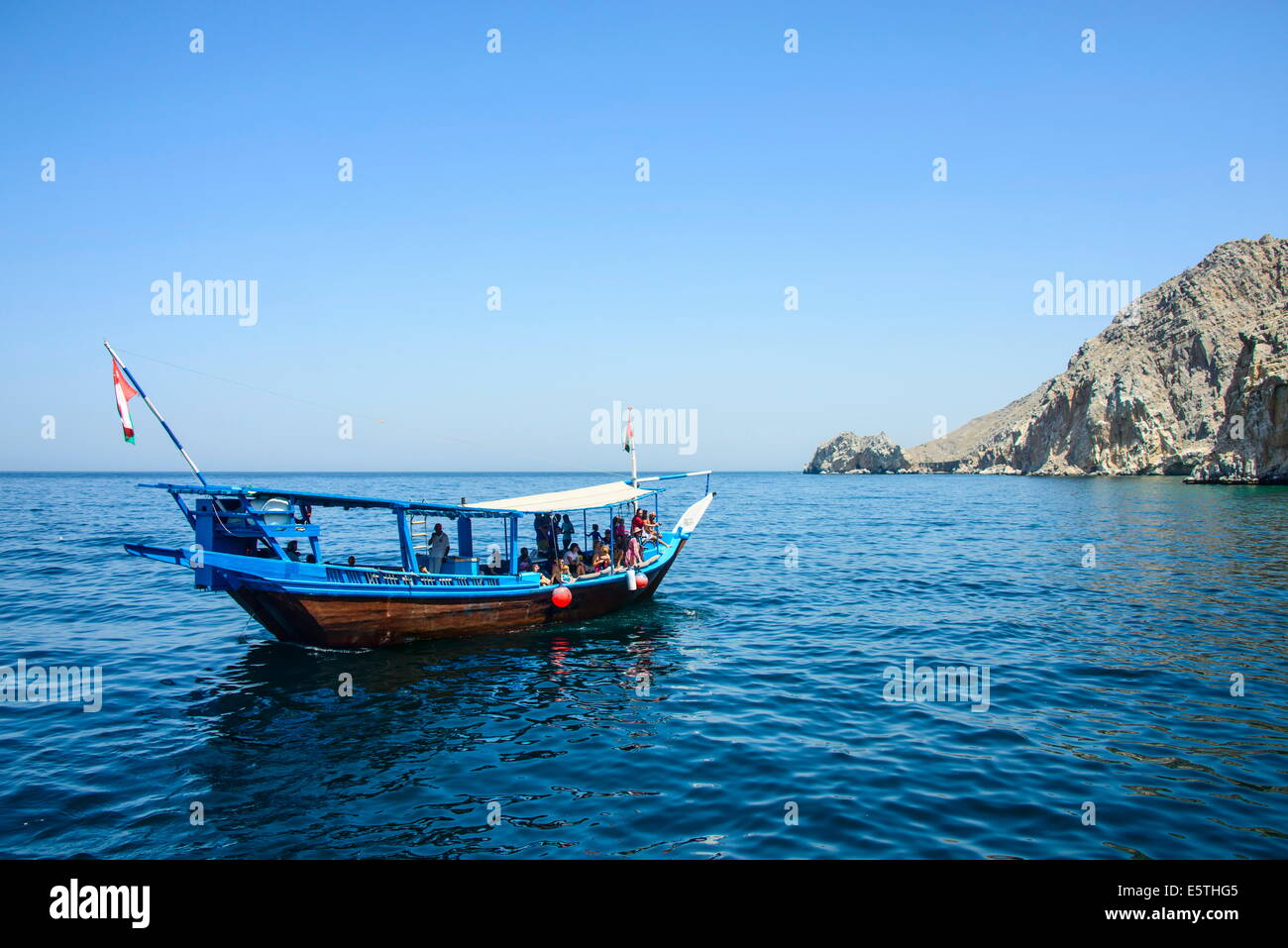 Tourist boat in form of a dhow sailing in the Khor ash-sham fjord, Musandam, Oman, Middle East - Stock Image