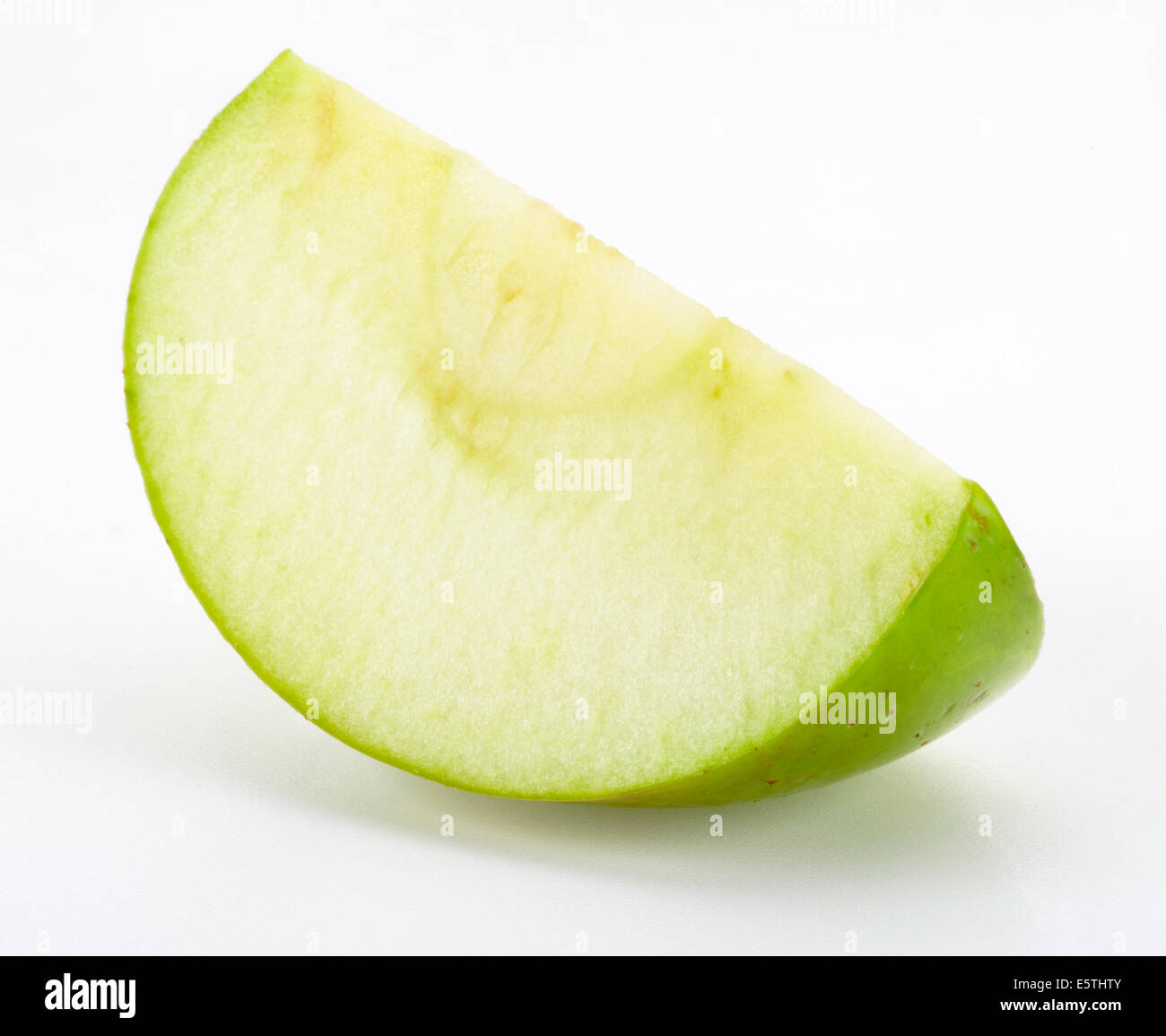 SLICE OF BRAMLEY COOKING APPLE - Stock Image