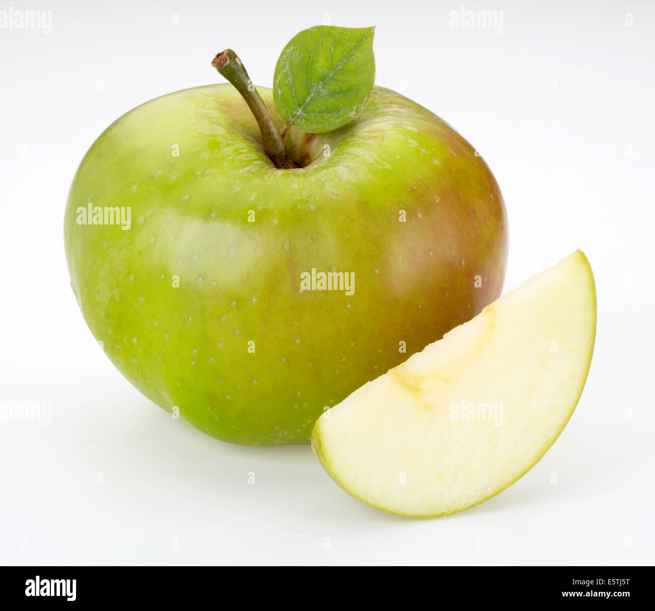 FRESH BRAMLEY APPLES WITH SLICE - Stock Image