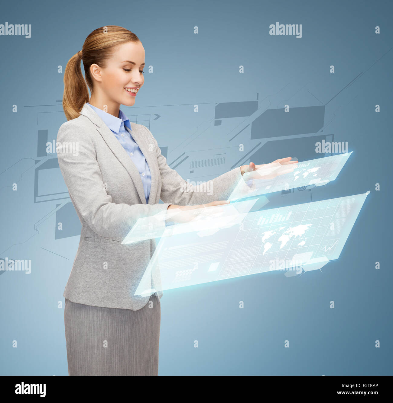 smiling businesswoman working with virtual screens - Stock Image