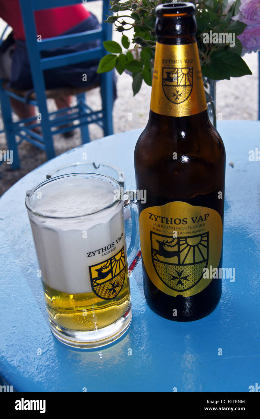 A bottle and glass of Zythos Vap Greek beer at the Therma hot springs bar, Kos, Greece - Stock Image