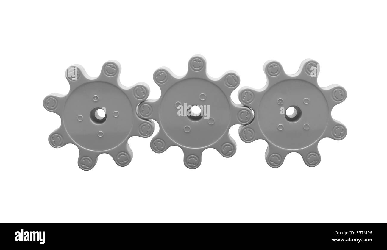 Three plastic gears isolated on white background - Stock Image