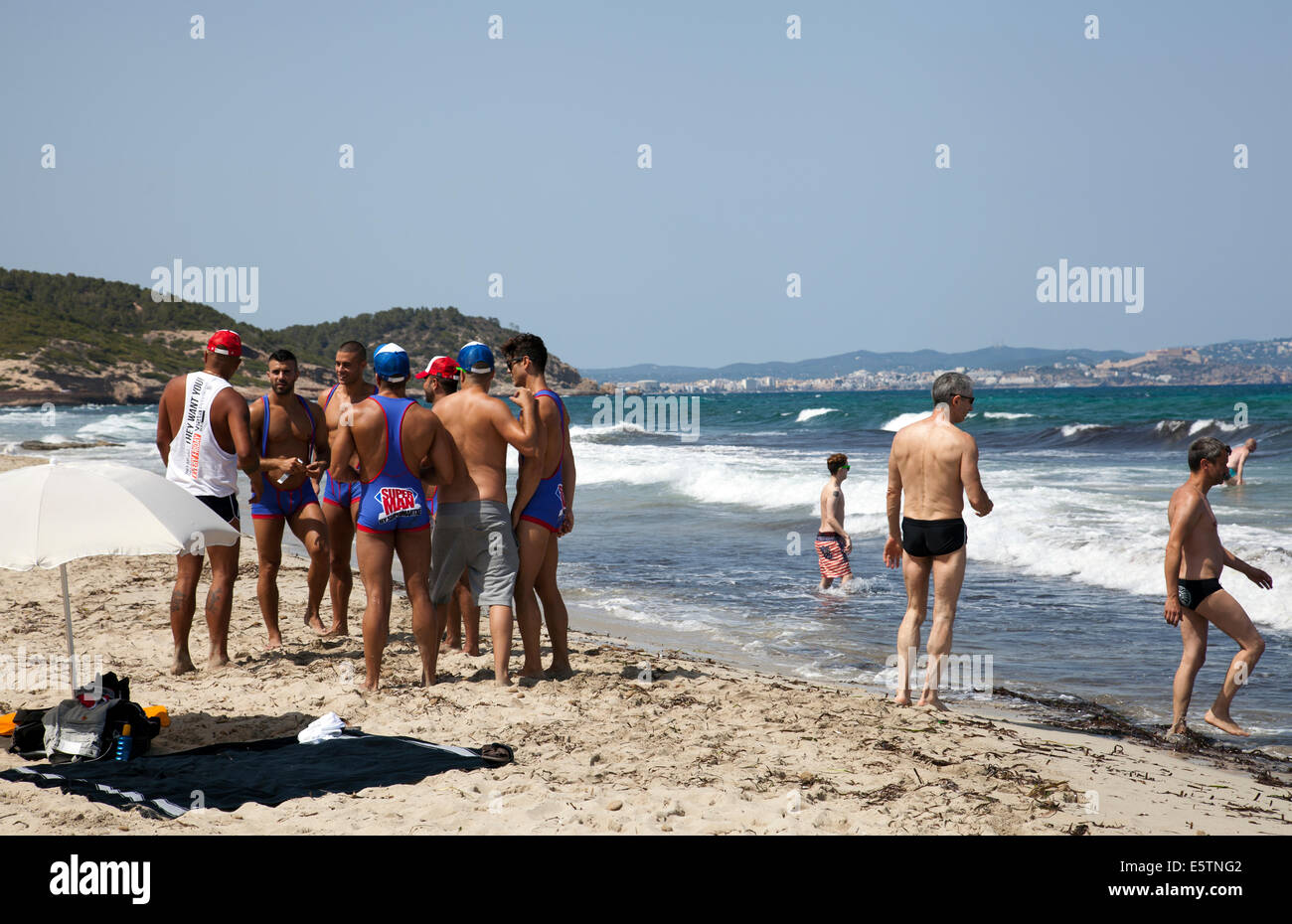Superman Club Night Promoters on El Chiringay Beach in Ibiza - Stock Image