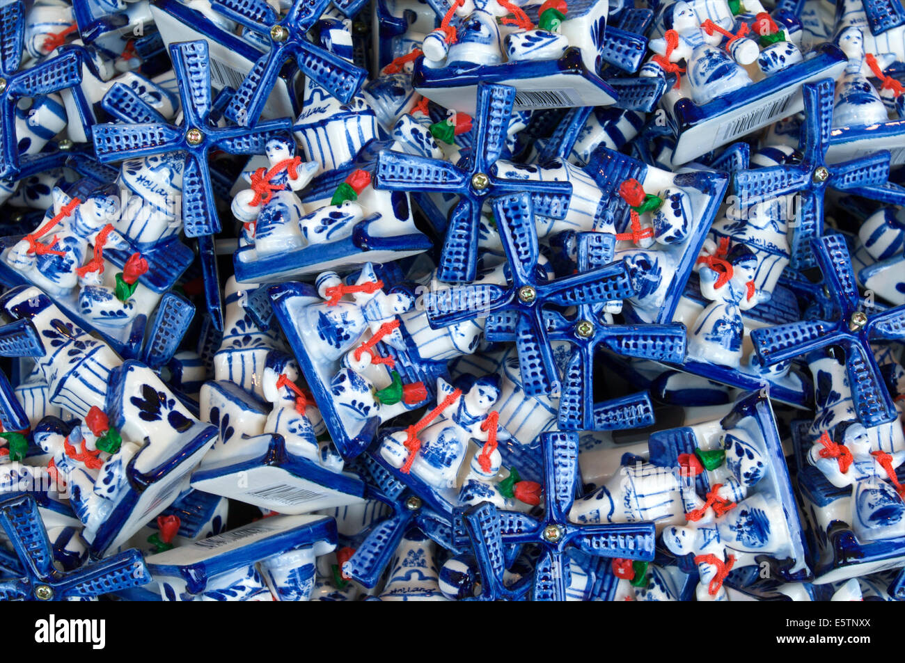 A basket with Delft Blue pottery windmills as souvenirs in a shop in Volendam, The Netherlands - Stock Image