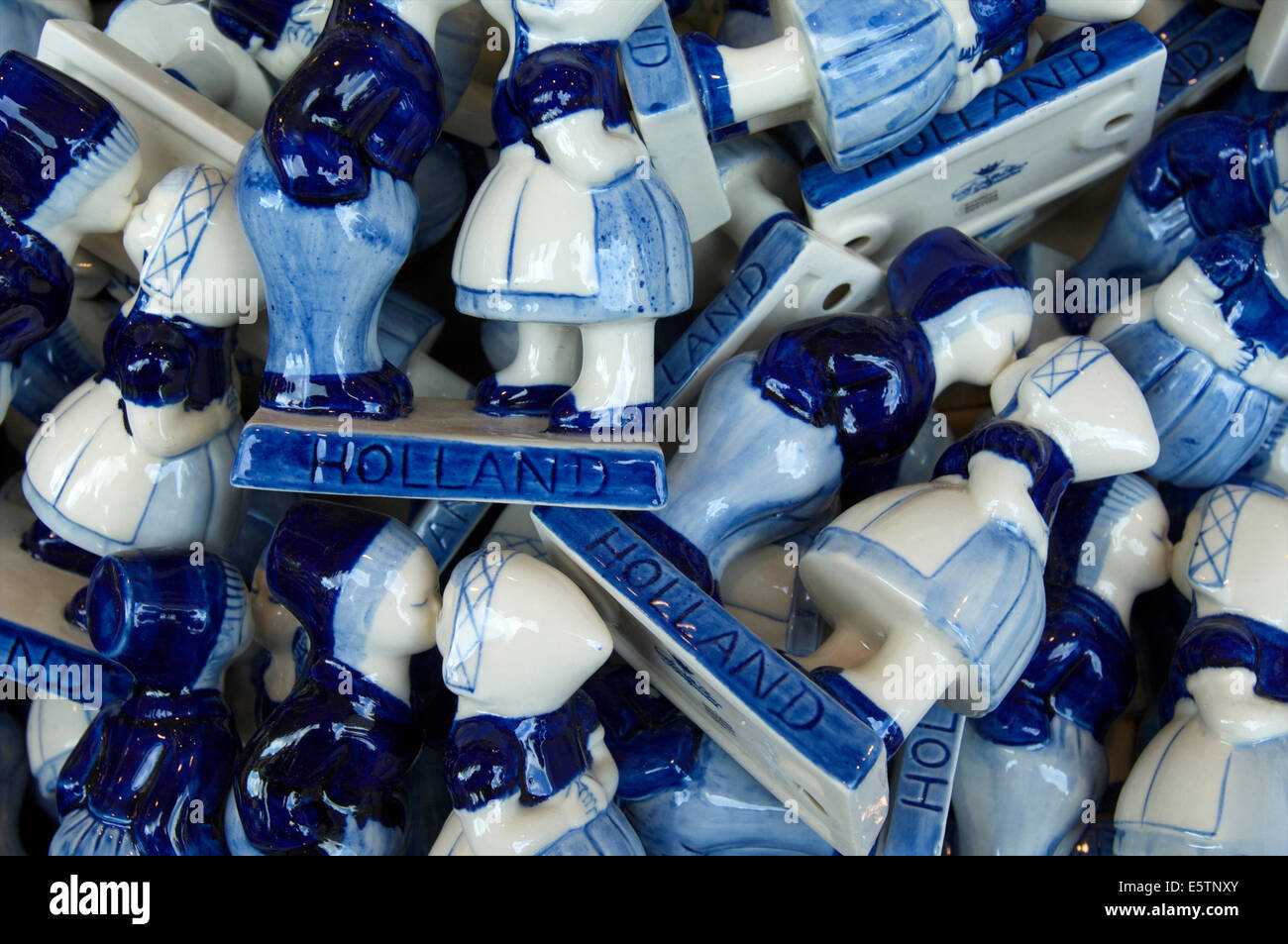 A basket with Delft Blue pottery dolls in traditional costume as souvenirs in a shop in Volendam, The Netherlands - Stock Image
