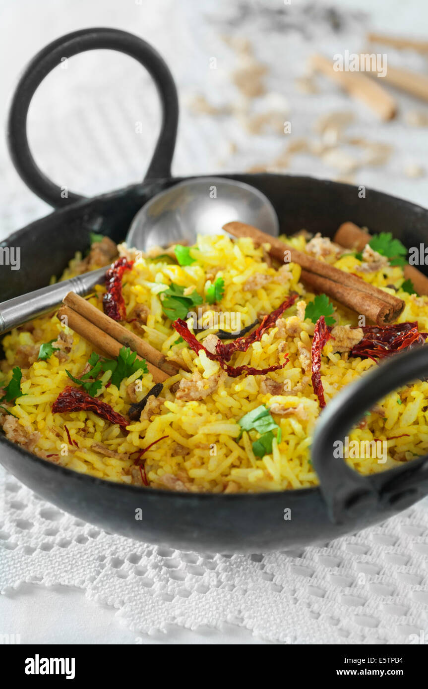 Pilau rice in karahi cooking pot - Stock Image
