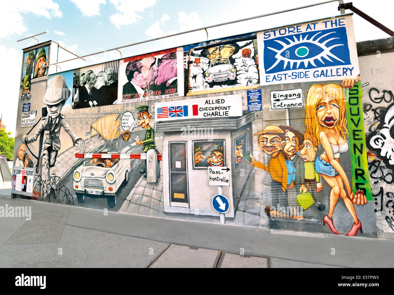 Germany, Berlin: Recreated wall paintings of the Berlin Wall at  the Store of East Side Gallery - Stock Image