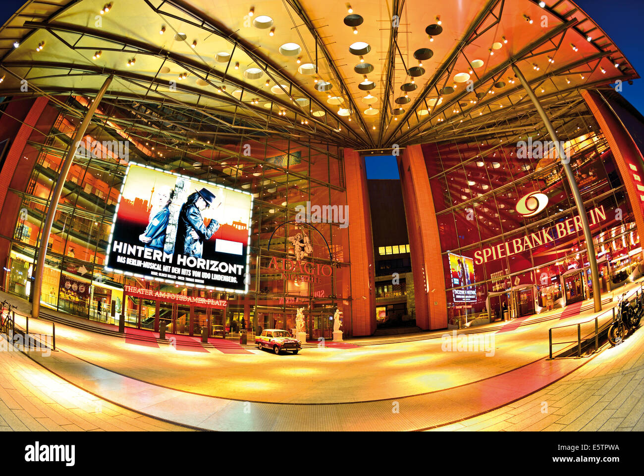 Germany, Berlin: Nocturnal view of the Stage Theater at Potsdamer Platz with musical 'Hinterm Horizont' - Stock Image
