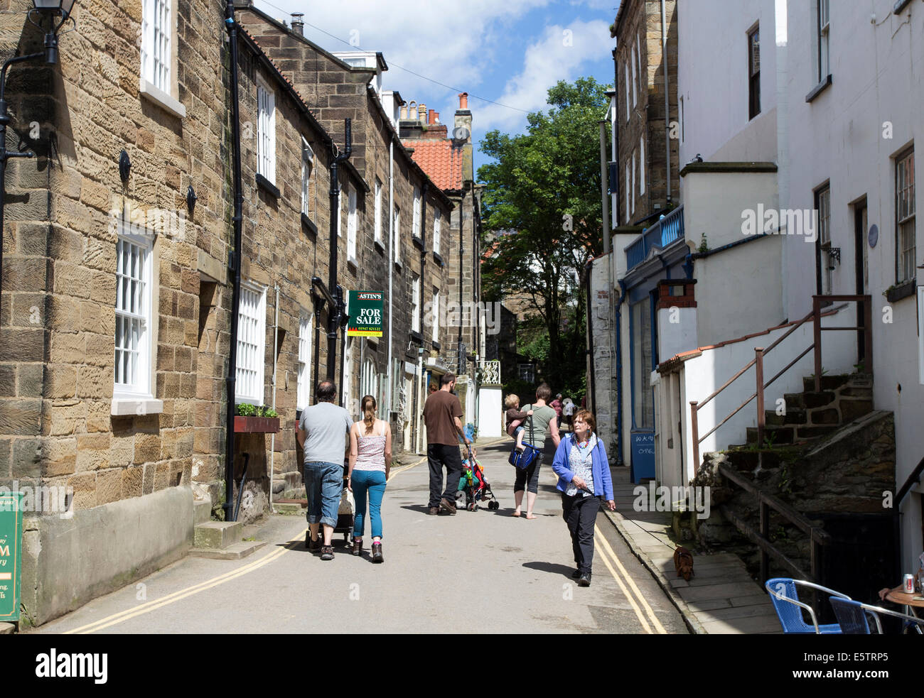 Street Scene with House For Sale Sign in Robin Hood's Bay, North Yorkshire England UK - Stock Image