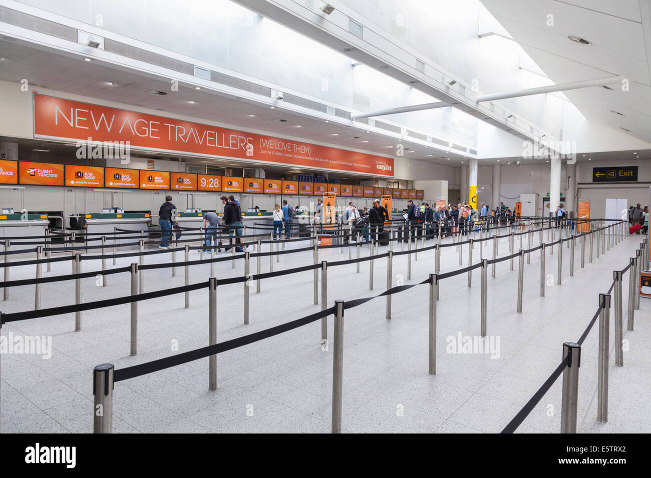 Almost empty check in area for Easyjet flights. - Stock Image