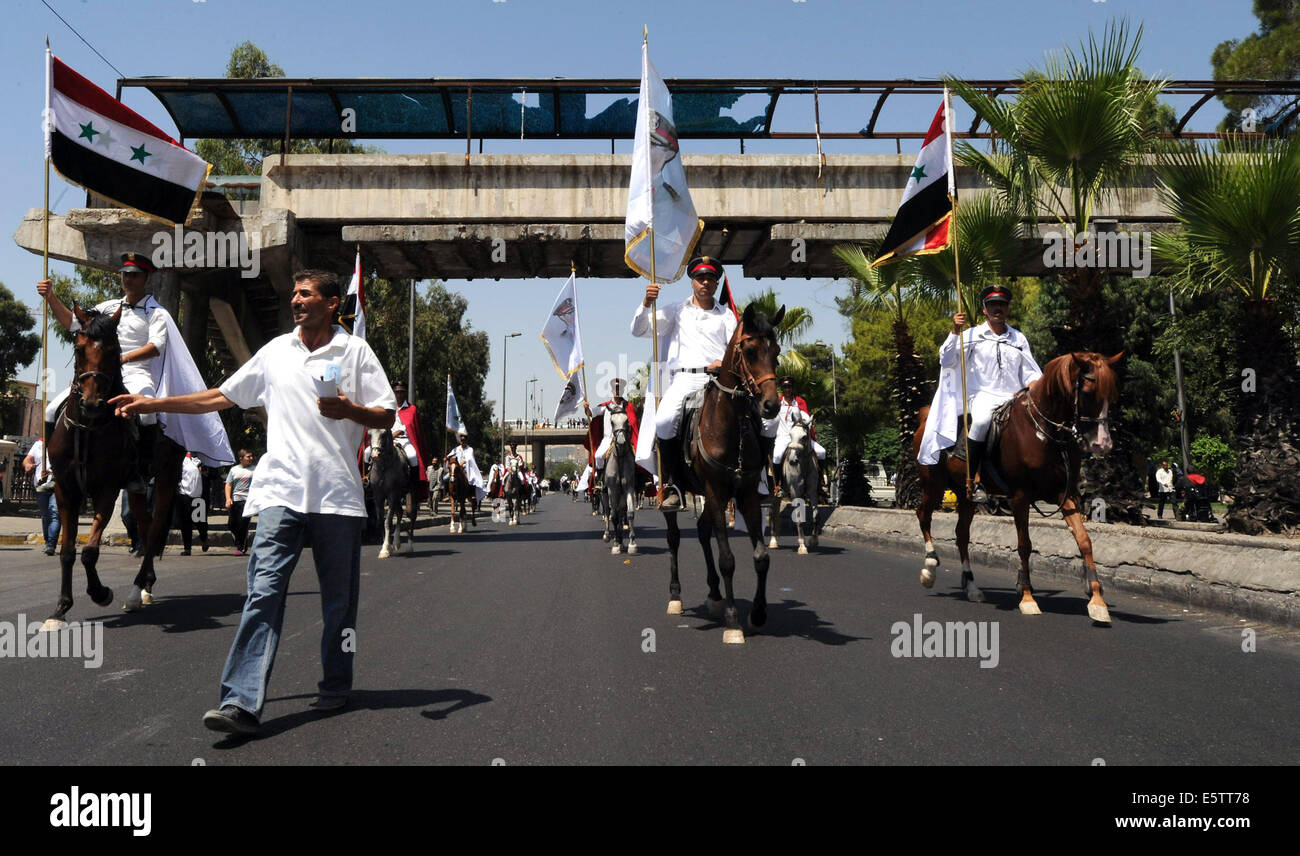 Damaskus. 6th Aug, 2014. Syrian equestrians are seen during a horse show organized in downtown Damascus, Syria, - Stock Image