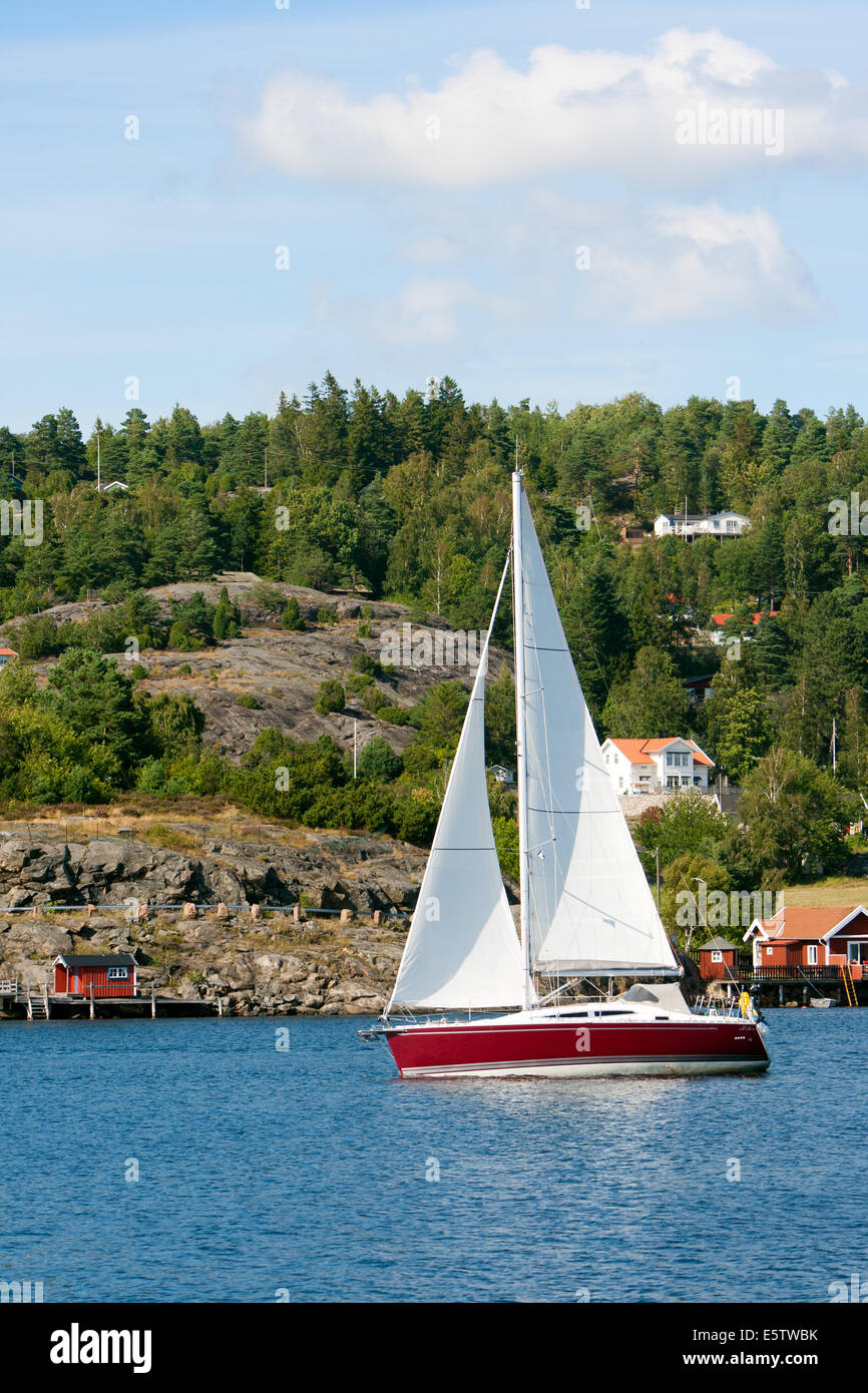 Sail yacht on a lake in Sweden - Stock Image
