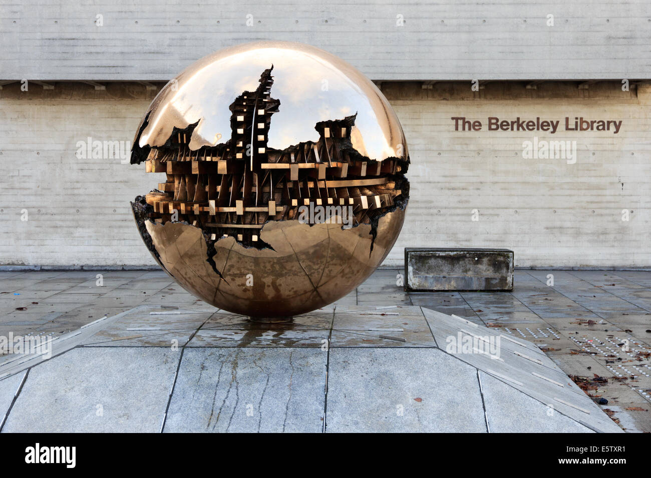 Abstract spherical metal sculpture on a courtyard of Trinity College in Dublin, Ireland. - Stock Image