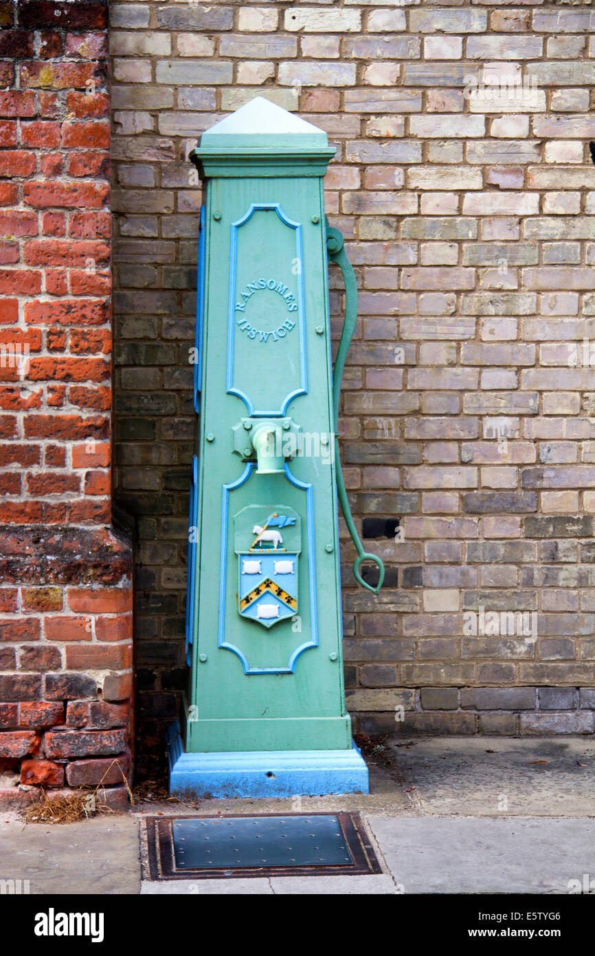 Old village water pump in Market Place, Hadleigh, Suffolk UK, manufactured by Ramsomes of Ipswich, - Stock Image