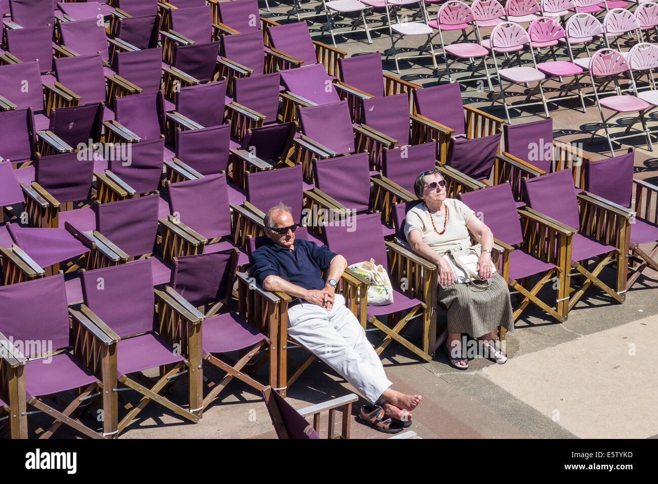 Elderley Couple asleep at Eastbourne Bandstand - Stock Image