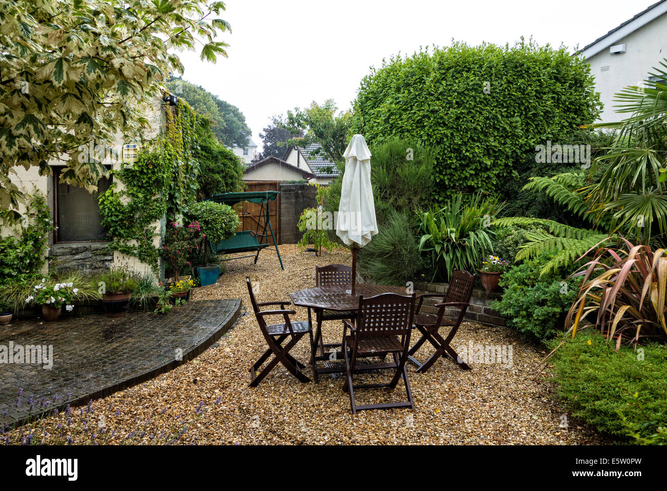 A wet and rainy Irish garden in mid-summer - Stock Image