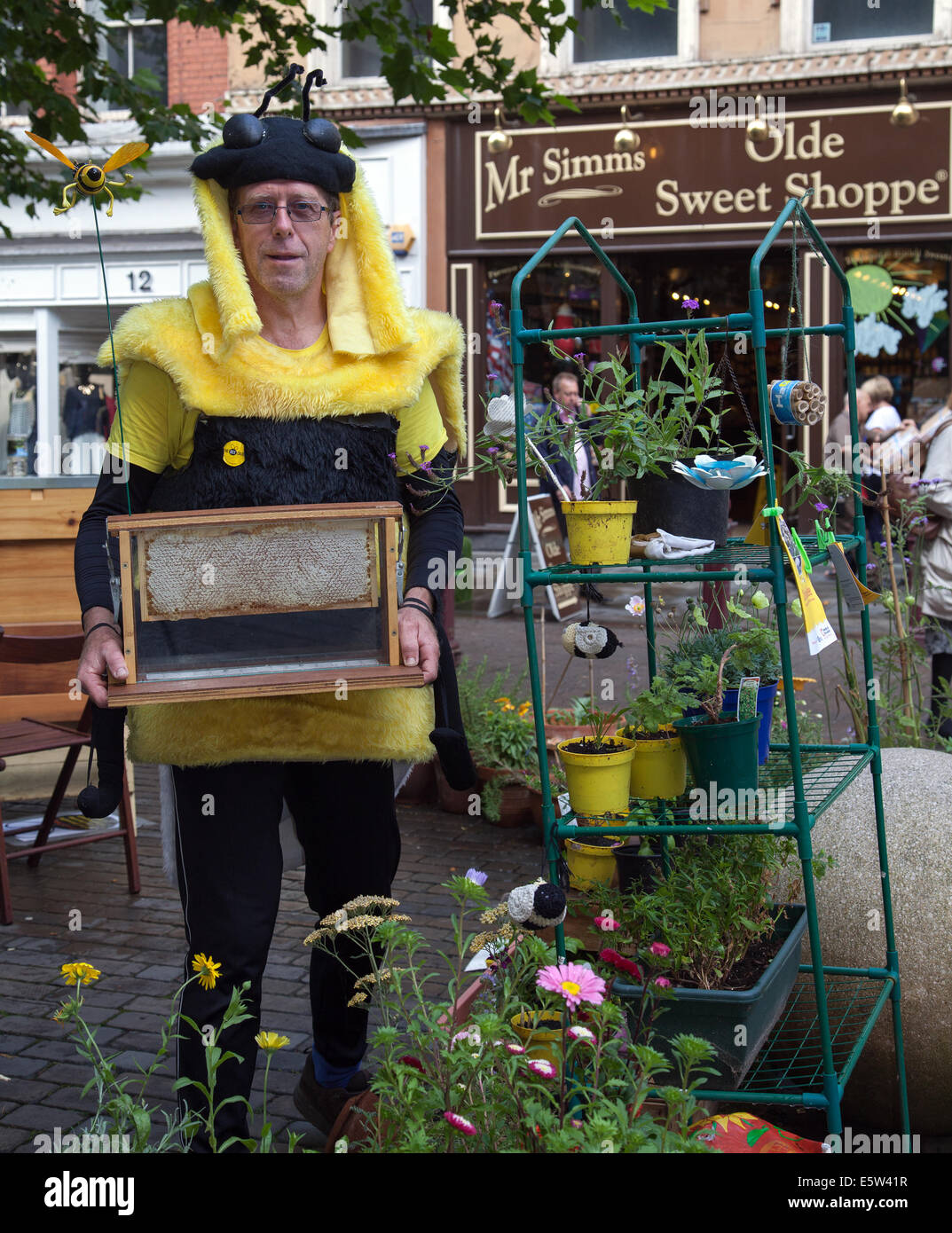 Man in bee costume holidng beehive honeycomb in Manchester, UK  Friends of the Earth Pete Abel at the Dig the City - Stock Image