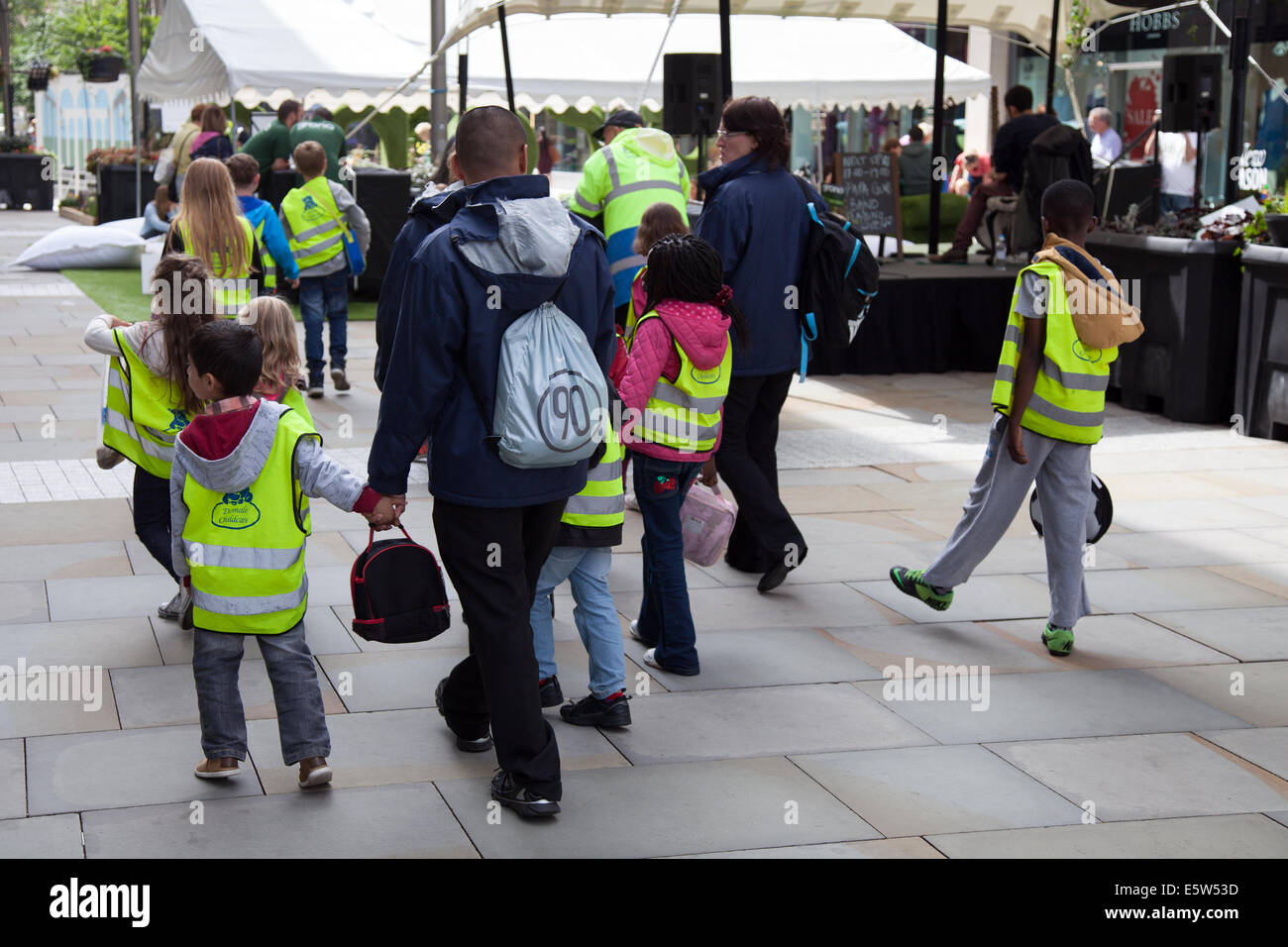Manchester, UK 6th August 2014. Childcare at Dig the City Deansgate, an annual urban gardening festival delivered - Stock Image
