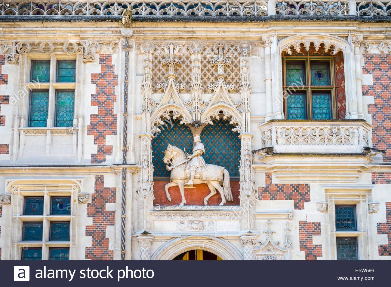 Statue of Louis XII on the front facade of Château Royal de Blois castle, Blois, Loire-et-Cher, Centre, France - Stock Image