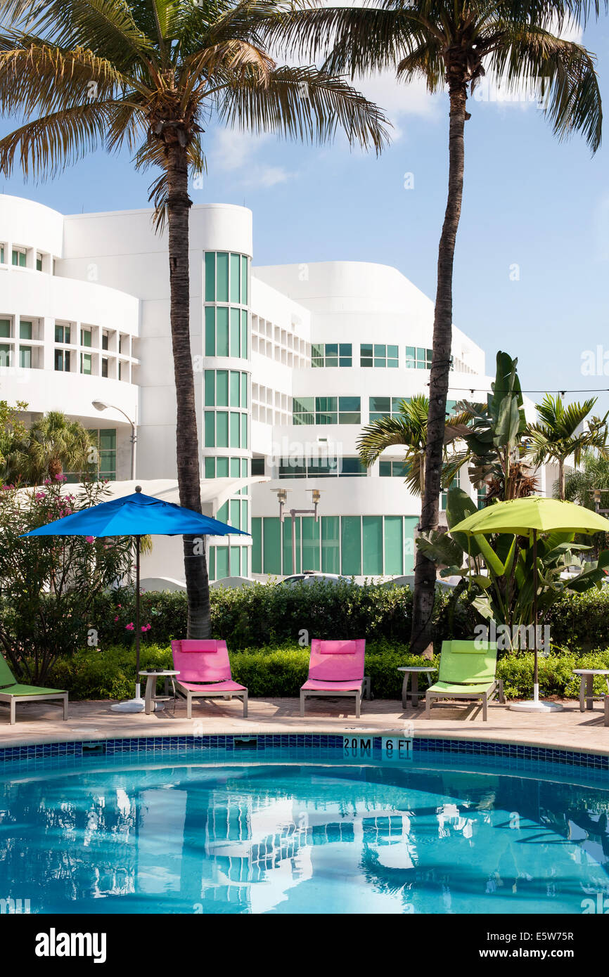 Miami Beach Hotel Pool With Sun Liongers And Umbrellas Stock Photo