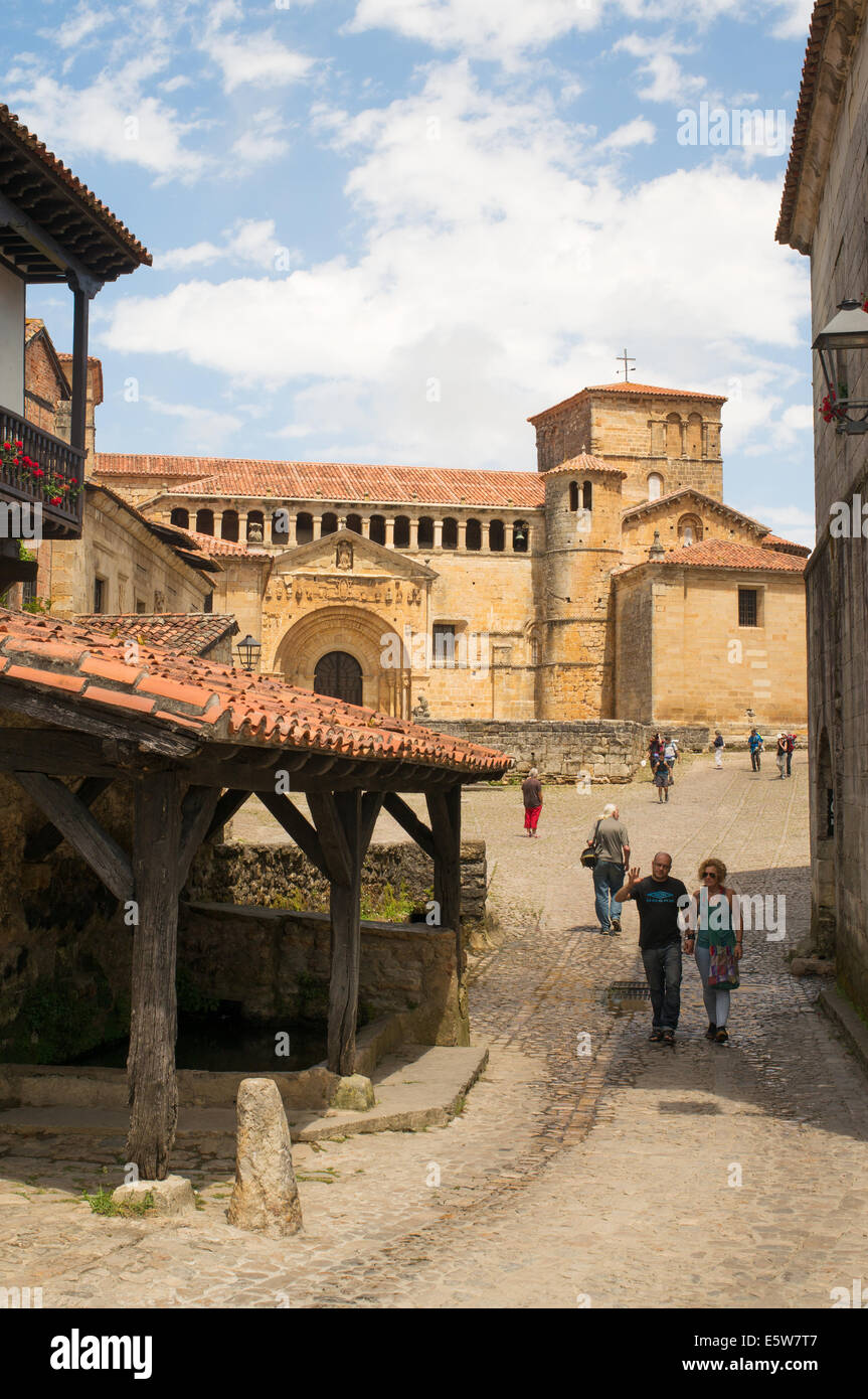 Couple walking past old wash house near Santa Juliana collegiate church, Santillana del Mar, Cantabria, Northern Stock Photo