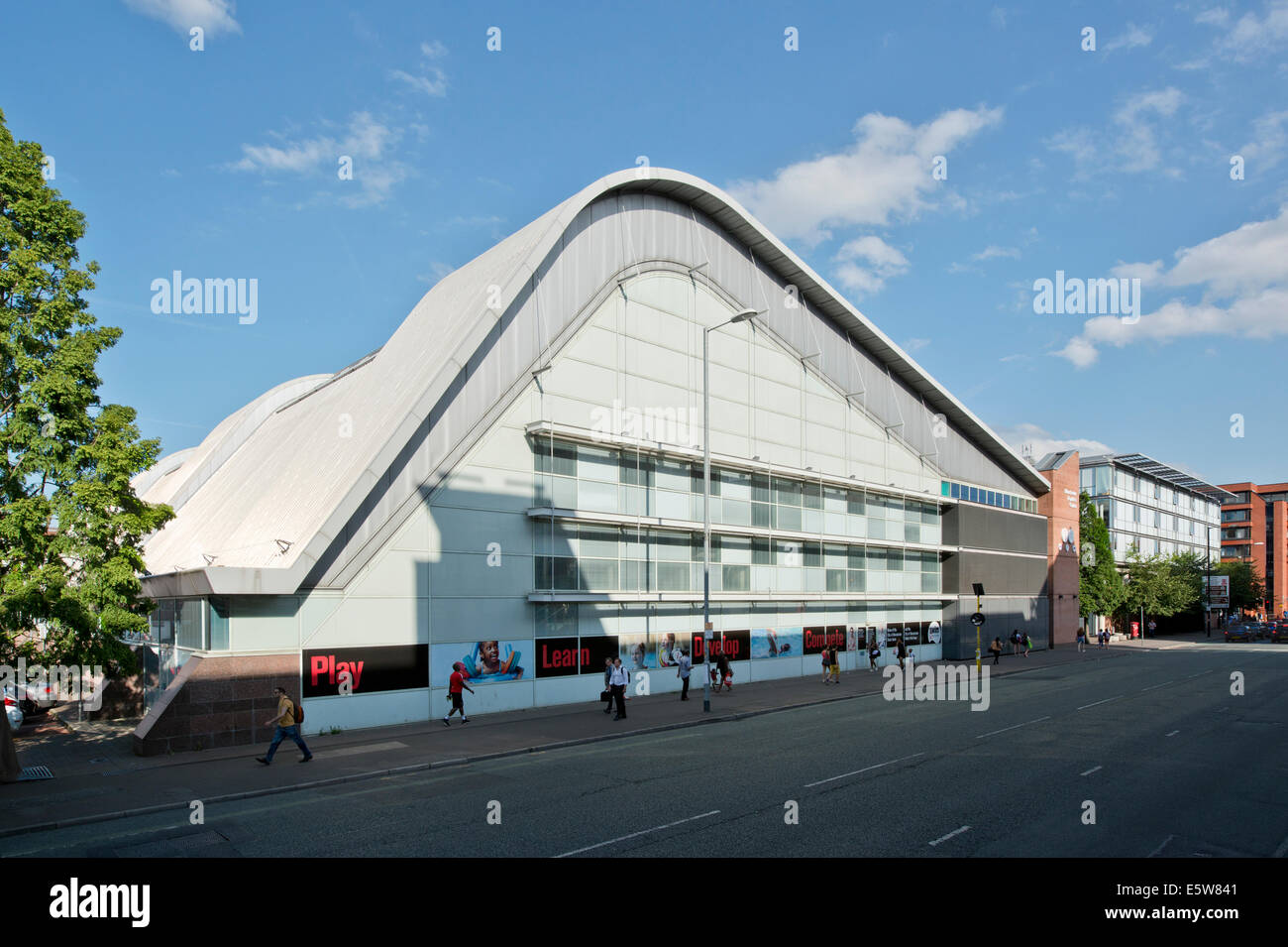 Manchester Aquatics Centre building on a sunny day, located on Oxford Road in the University campus area of the - Stock Image