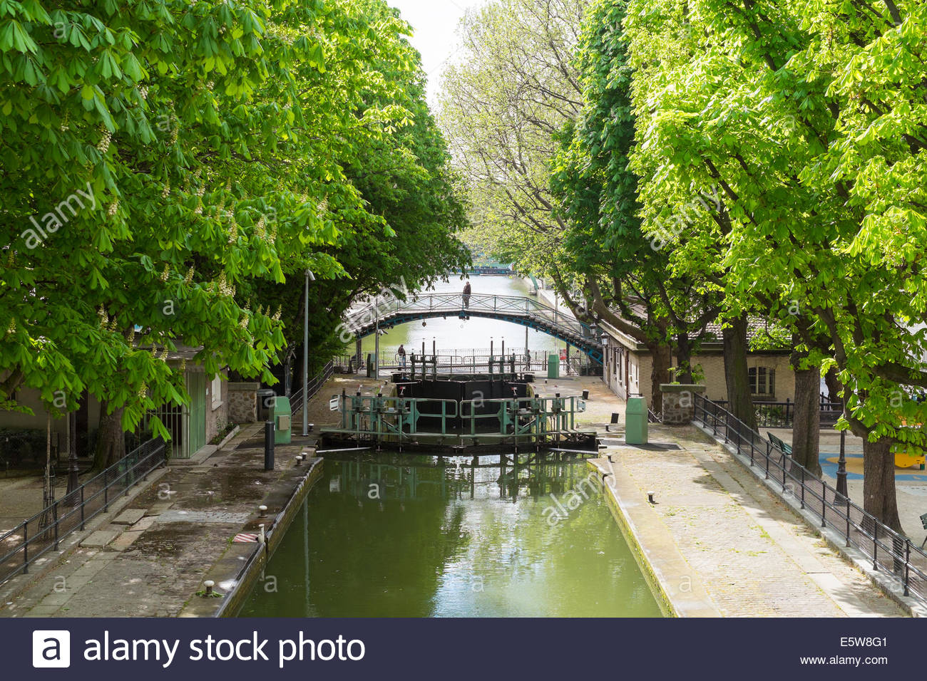 Locks and footbridges along the Canal St. Martin, Paris, Îsle-de-France, France - Stock Image