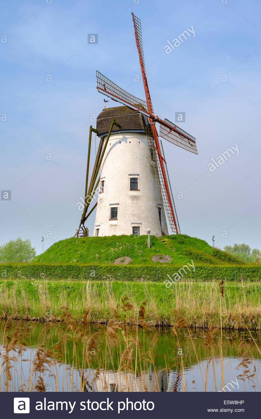 Windmill along canal, Damme, West Flanders, Belgium - Stock Image