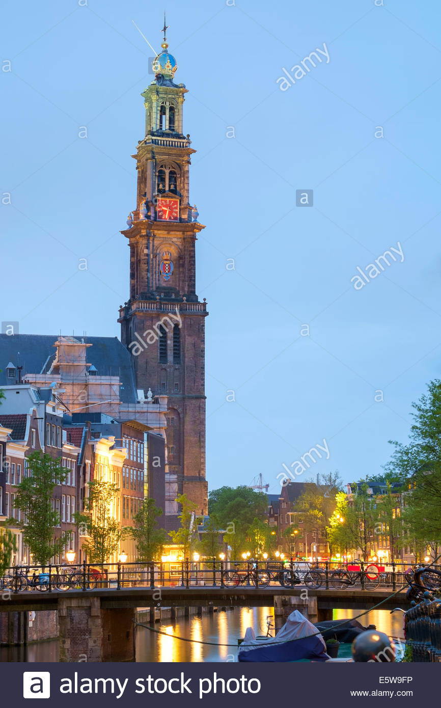 Prinsengracht canal and tower of the Westerkerk church at dusk, Amsterdam, North Holland, Netherlands - Stock Image