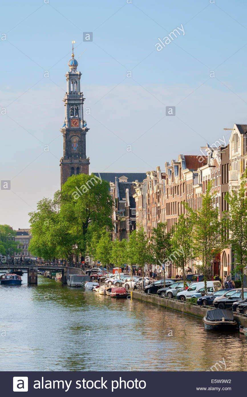 Tower of the Westerkerk church on the Prinsengracht canal in late afternoon, Amsterdam, North Holland, Netherlands - Stock Image