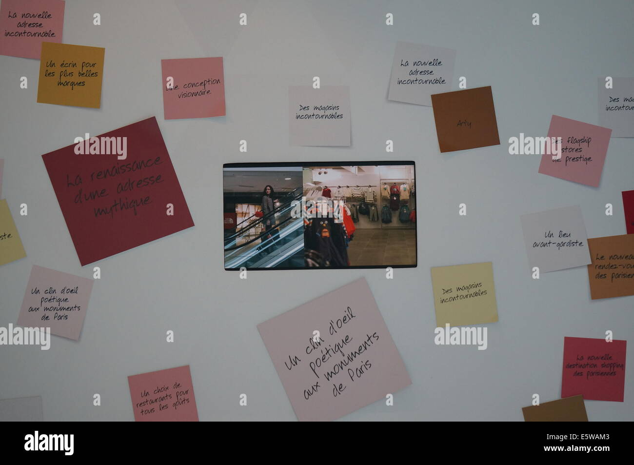 The design on the wall inside le centre commercial Beaugrenelle with LED screen broadcasting its commercials in - Stock Image