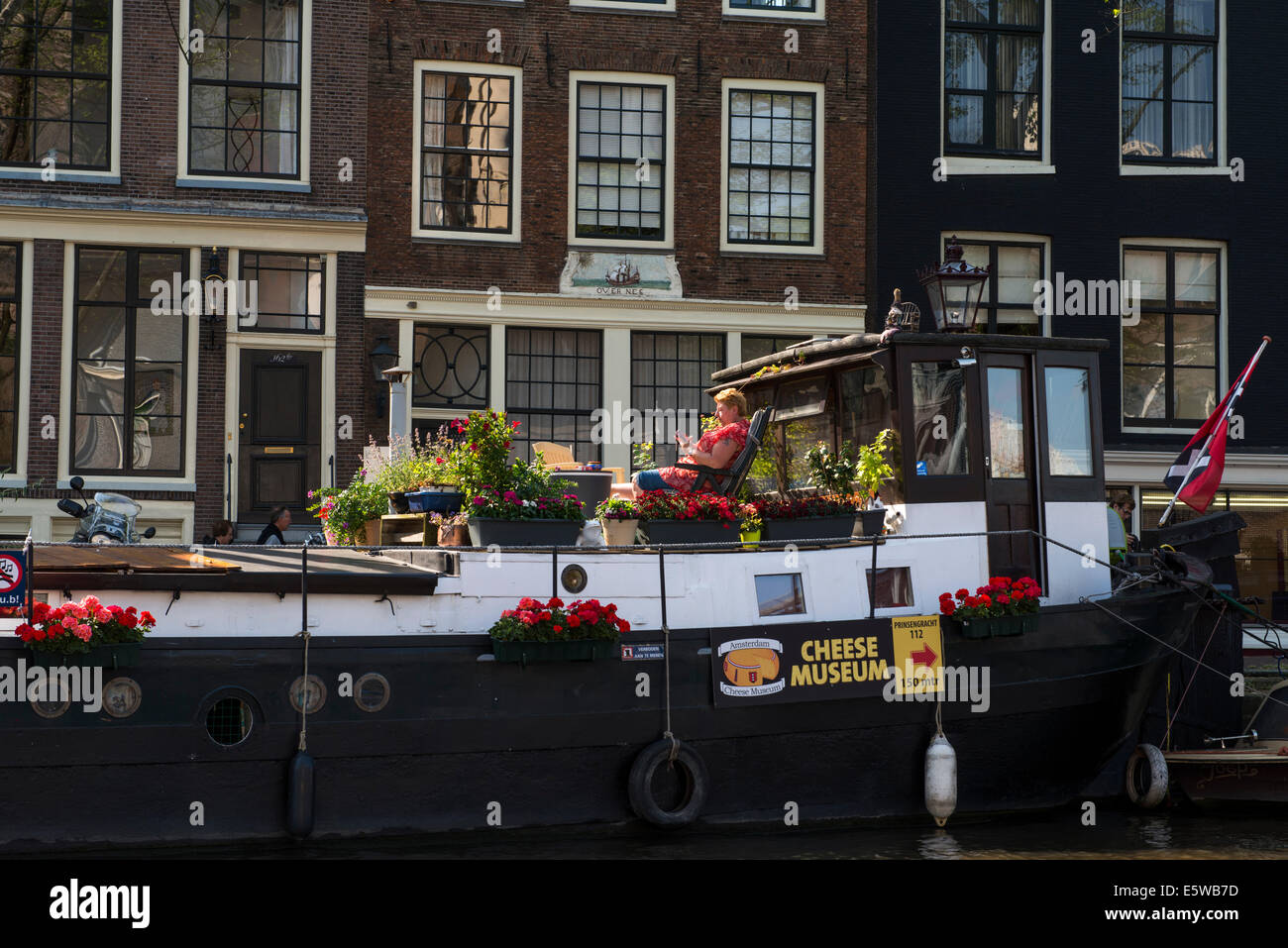 Woman on barge, Amsterdam, Holland, Netherlands, Cheese museum - Stock Image