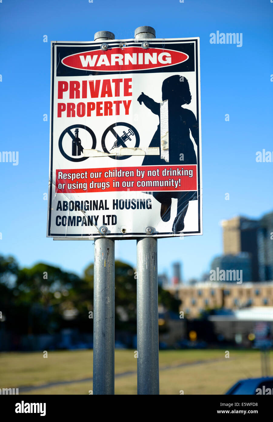 Sign encouraging people not to abuse drugs or alcohol in order to protect children and the community. - Stock Image