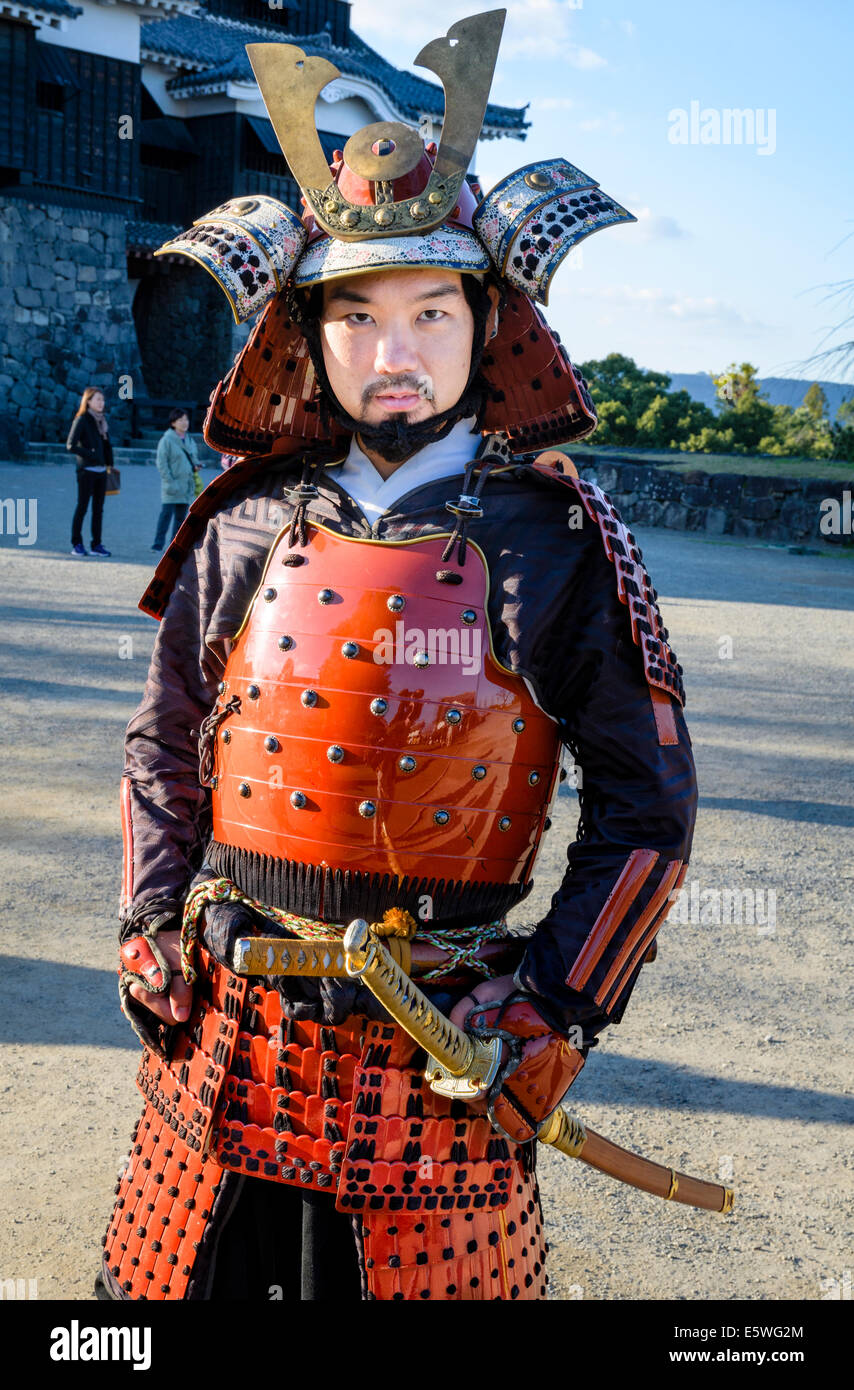 Japanese Man Wearing Traditional Samurai Armour Armor Including Helmet And Swords