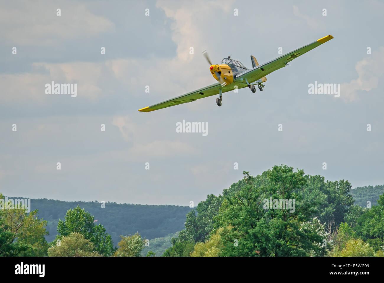 Historic german bomber Zlin 205 approaching the battlefield during reenactment of World War II fights - Stock Image
