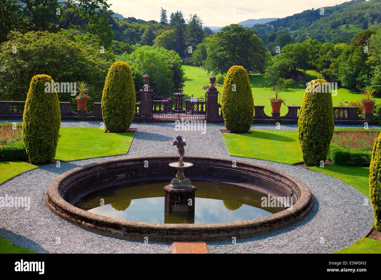 Circular pool in formal garden at Rydal Hall Cumbria UK - Stock Image