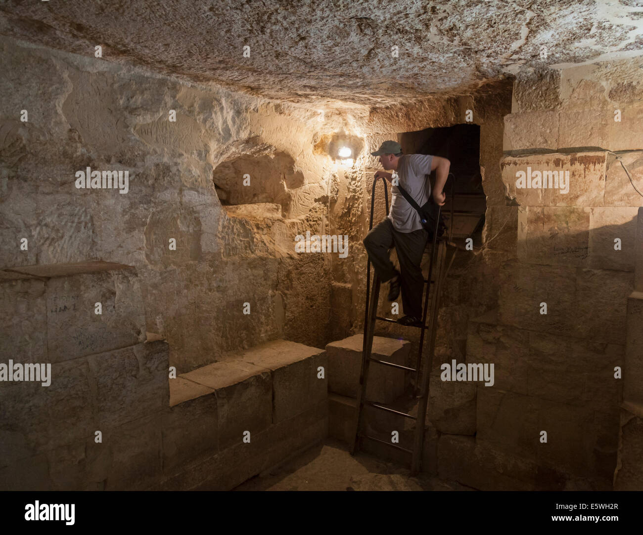 Tourist inside one of Pyramids of Giza in Cairo, Egypt - Stock Image