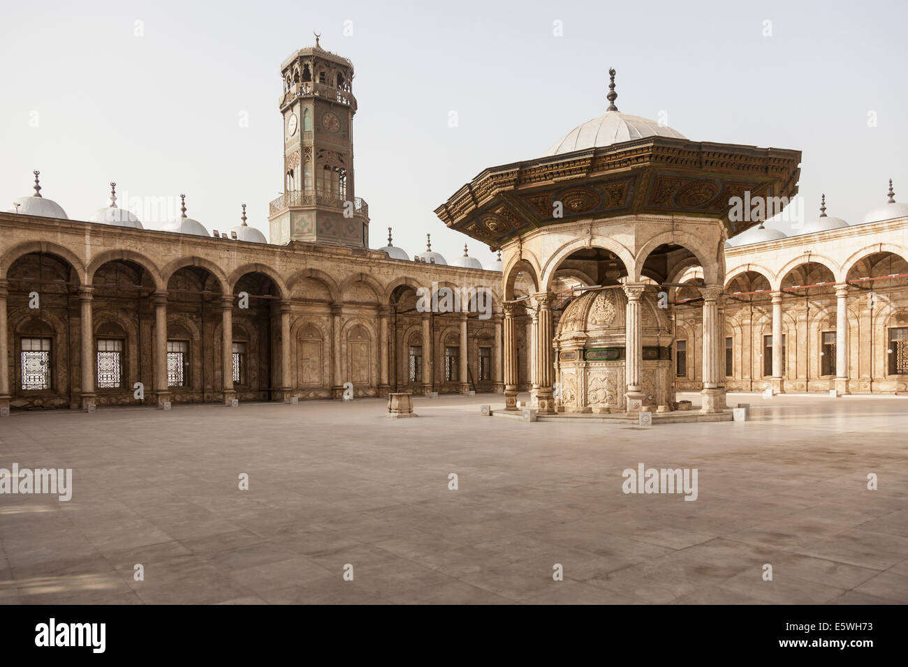 Interior courtyard and clock tower, Alabaster Mosque / Mosque of Muhammad Ali Pasha in the Citadel in Cairo, Egypt - Stock Image