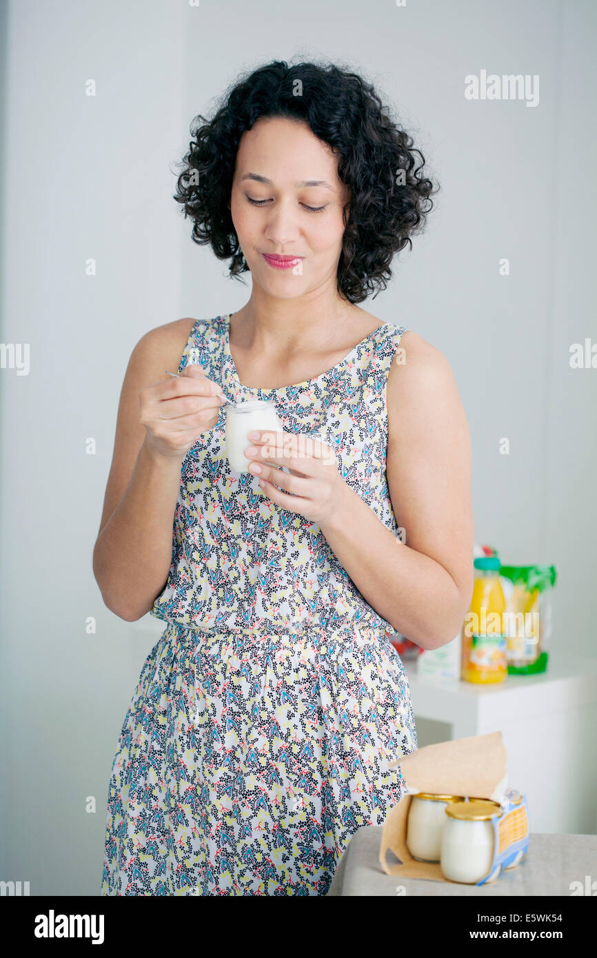 Woman, dairy product - Stock Image