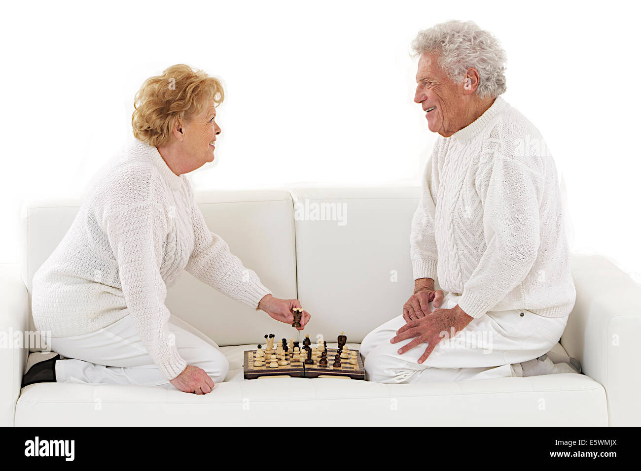 ELDERLY PEOPLE PLAYING CHESS - Stock Image