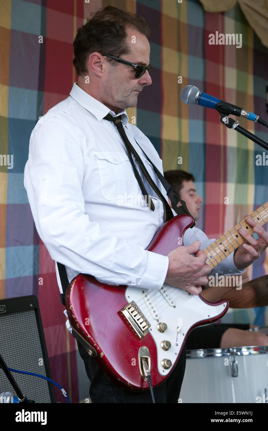 John Batten, lead guitarist with the Hit Men UK, performing at the Brockley Max Festival on Hilly Fields Park, Lewisham Stock Photo