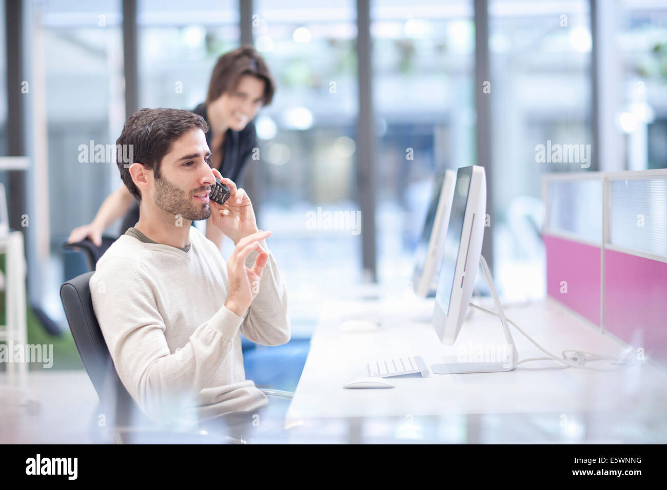 Male office worker on landline phone - Stock Image